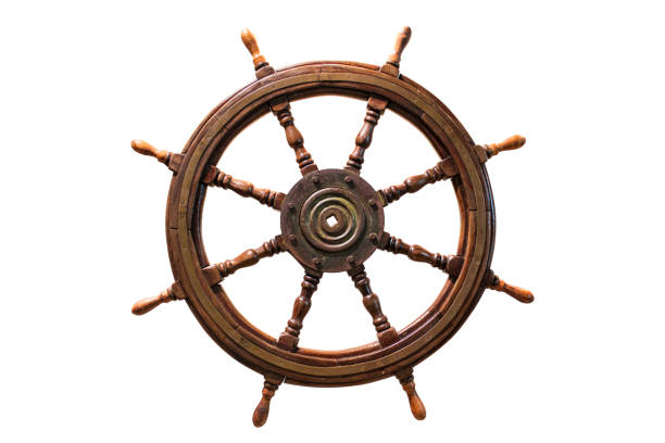 vintage ship wheel made of wood. isolated on white background. stock photo