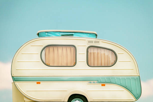 Vintage side of a caravan Vintage side of a caravan in two tone green and white caravan photos stock pictures, royalty-free photos & images