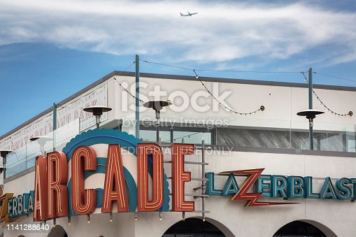 San Diego, California: Horizontal close-up view of the retro sign of the Lazerblast Arcade virtual game room at Belmont amusement Park, Mission Bay