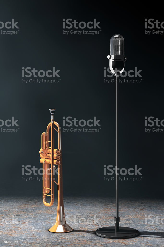 Vintage silver microphone with Polished Brass Trumpet in the vol stock photo
