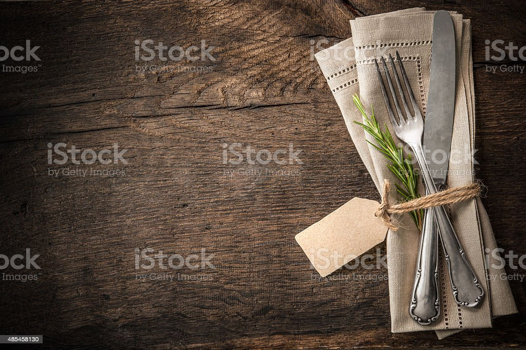 Vintage silverware with an empty tag stock photo