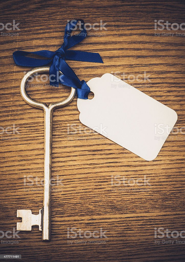Vintage Skeleton Key with Blank Tag stock photo