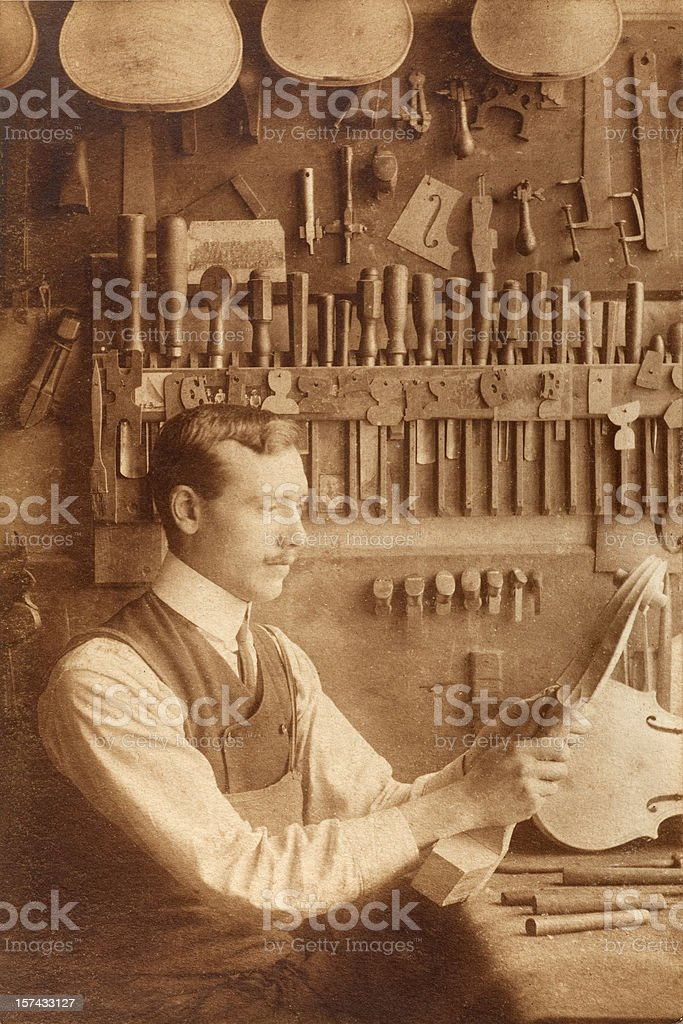 Vintage Skilled Luthier with Cello Scroll stock photo
