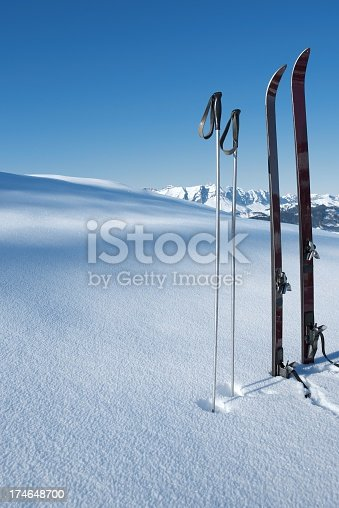 Old style ski's and poles in the snow