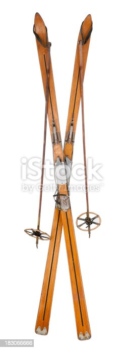 Antique skis & poles isolated on a white background. This is a high resolution composite image.