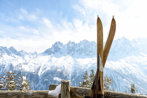 Vintage skis with Mont Blanc Massif behind