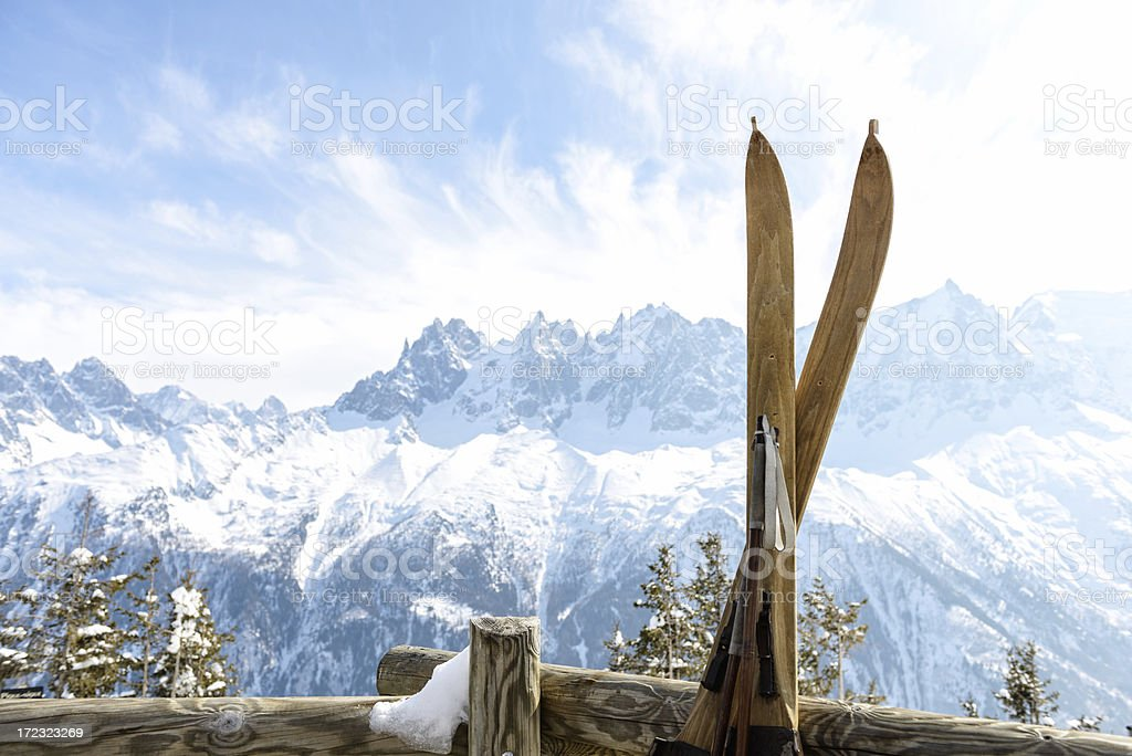 Vintage skis with Mont Blanc Massif behind stock photo