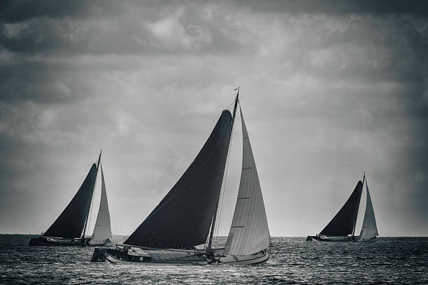 vintage skutsje sailboats racing - vintage nautical stock photos and pictures