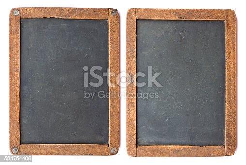 istock Vintage slake blackboard isolated on white. 584754406
