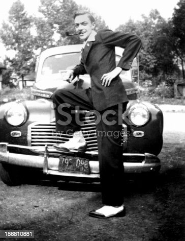 Check out this big spender leaning on his car in a pin striped suit with a pipe in his mouth.Vintage - from the late 1930's.