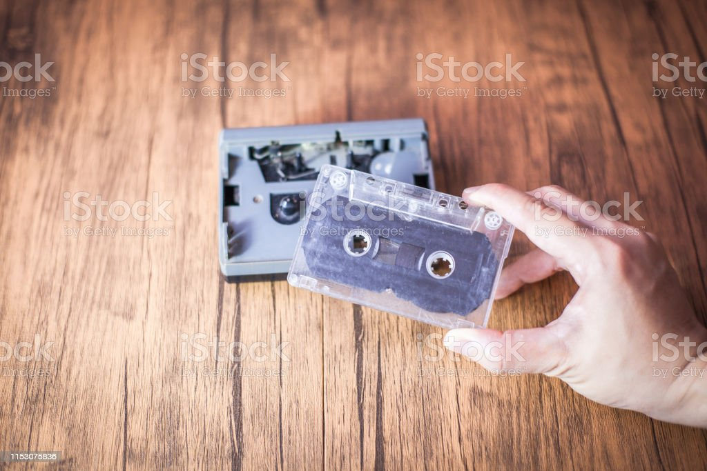 vintage songs concept . audio cassette tape on the wooden table ....