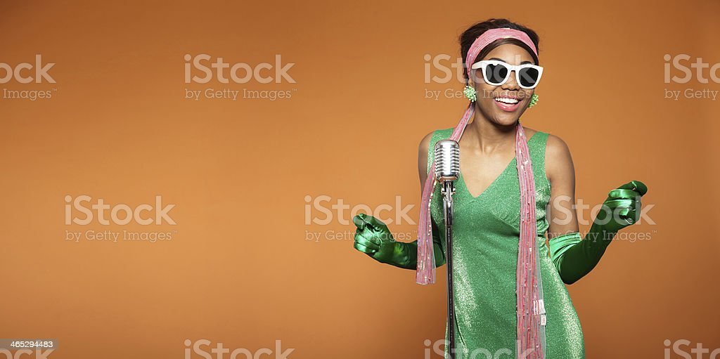 Vintage soul funk woman singing. Black african american. Copy space. stock photo