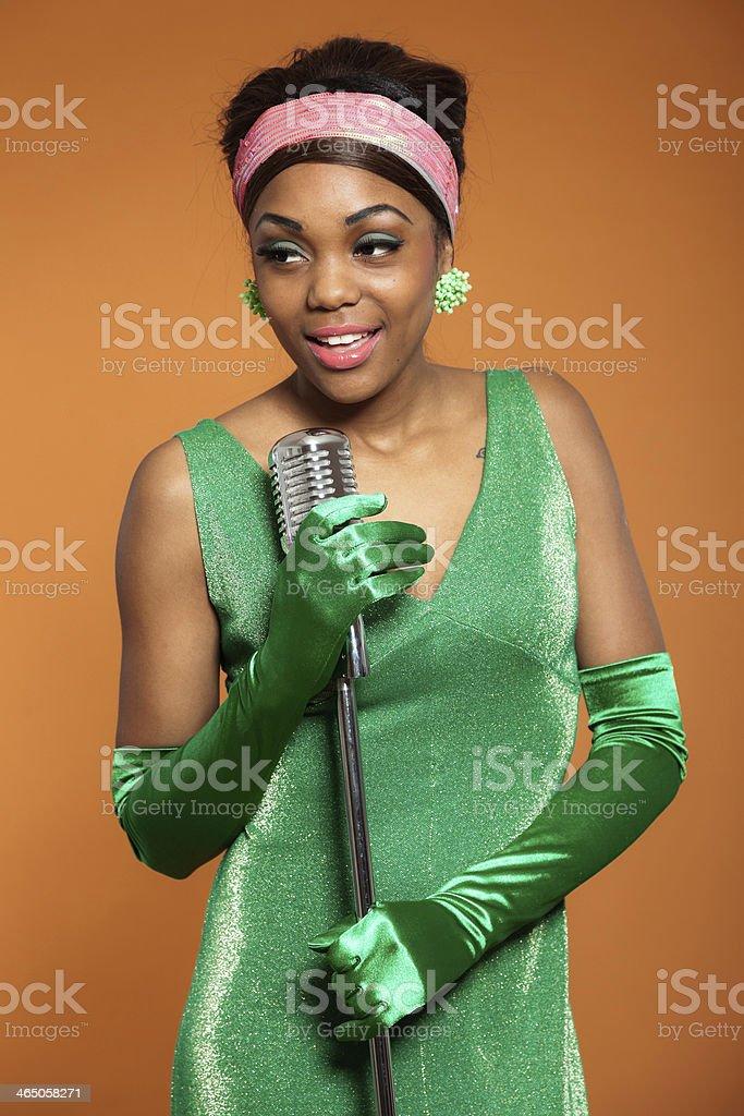 Vintage soul funk woman singing. Black african american. stock photo