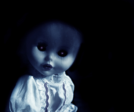 Vintage spooky doll