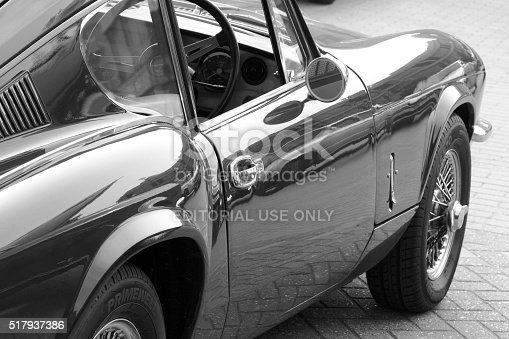 Somerset, England - October 04, 2015: A black and white photograph of the side and interior of a vintage sports car.