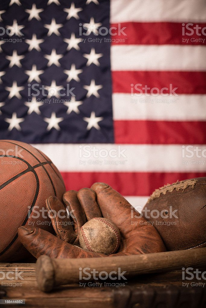Vintage Sports Equipment in Front of American Flag stock photo