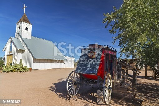 Vintage Wild West Stagecoach in Courtyard in front of Catholic Church near Lost Dutchman State Park, Apache Trail east of Phoenix Arizona