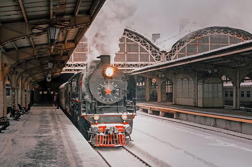 Soviet steam locomotive. Station in Art Nouveau style.