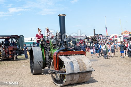 Blandford Forum.Dorset.United Kingdom.August 24th 2019.A vintage steam powered Aveling and Portrer steam roller is being driven  at The Great Dorset Steam Fair.