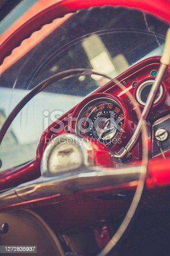 old red vintage steering wheel in cuba.