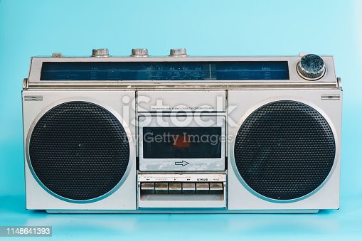 1043737676 istock photo Vintage stereo on blue pastel color background 1148641393