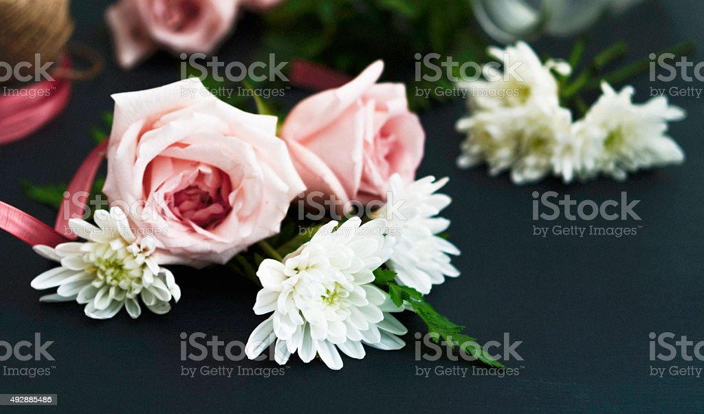 Vintage still life of flower arranging with roses and dahlia stock photo