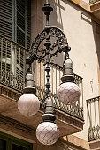 Detail of a vintage street lamp in downtown of Barcelona, Ferran street, Barri Gotic, Catalonia, Spain, Europe
