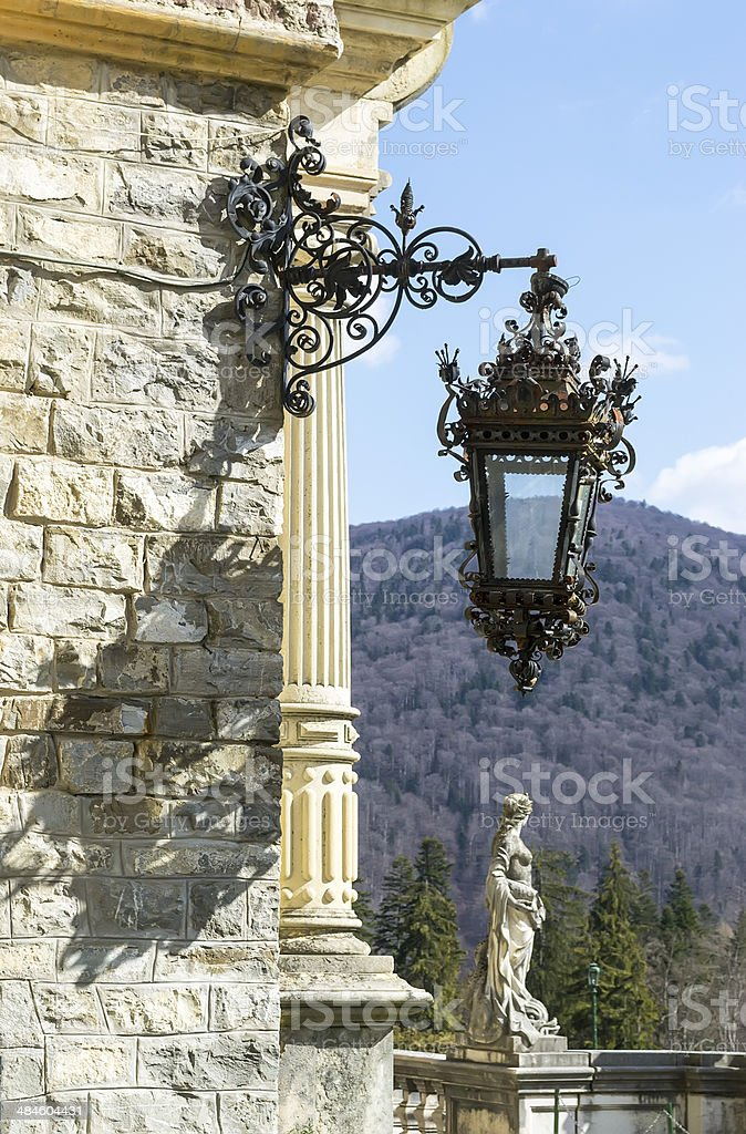 Vintage street lamp with statue stock photo