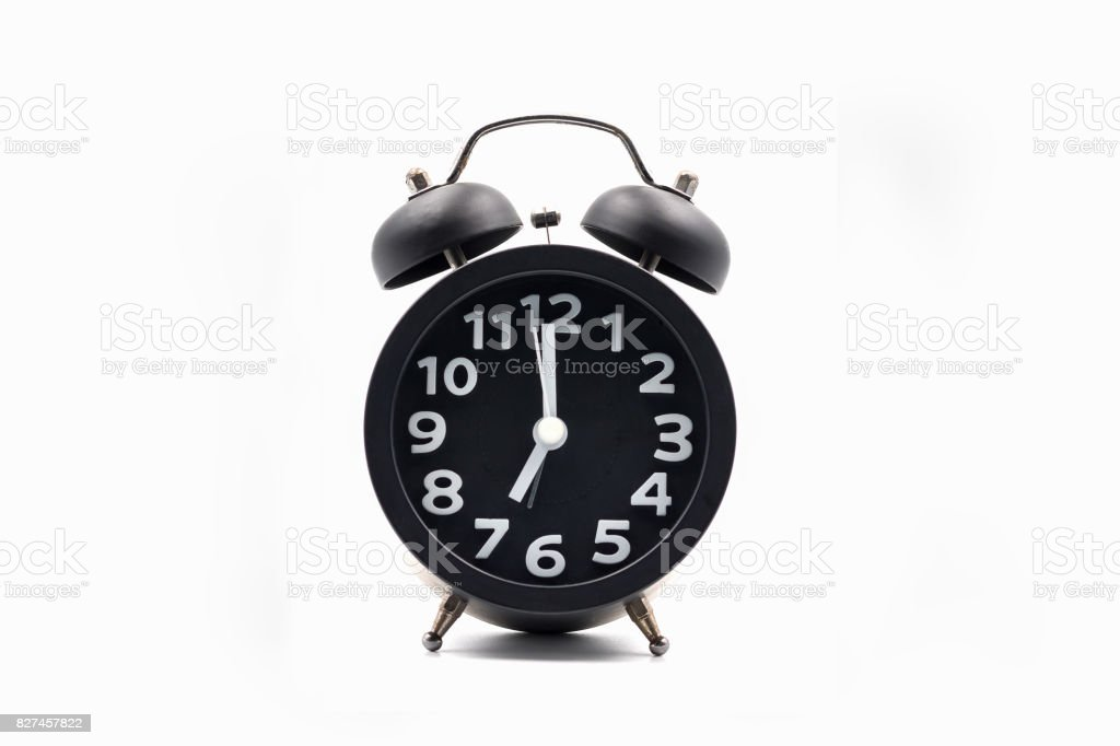 Vintage style alarm clock on white background stock photo