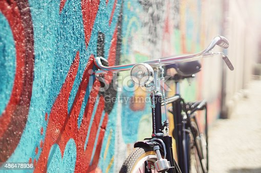 Old style dutch bicycle on graffiti wall.