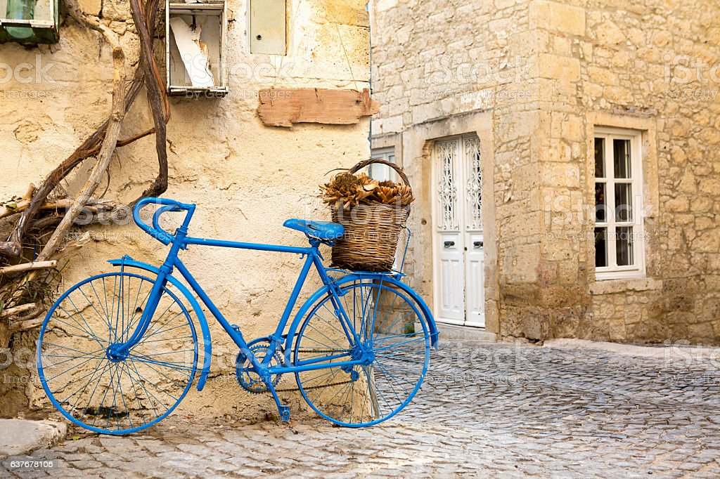 Vintage Style Blue Painted Bicycle in Alacati Streets stock photo