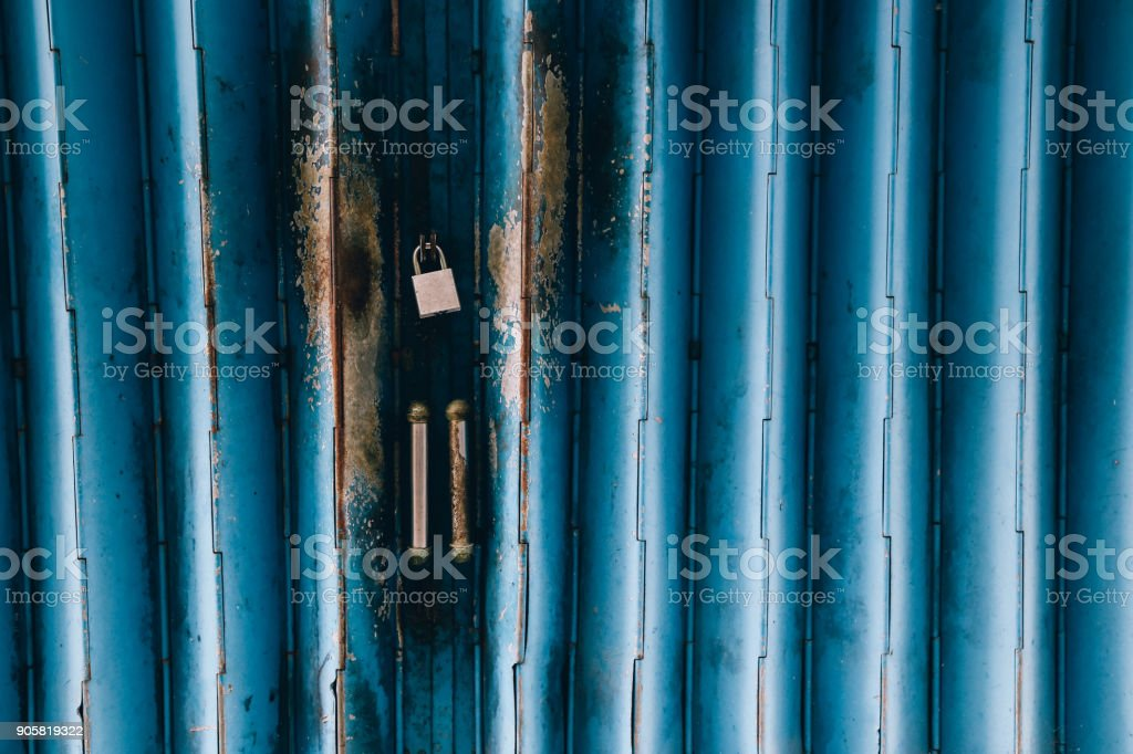 vintage style blue shutter door background stock photo