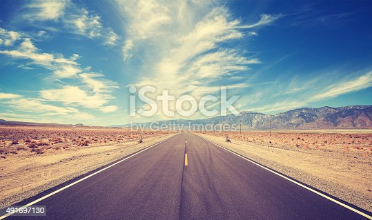 Vintage style country highway in USA, travel adventure concept.