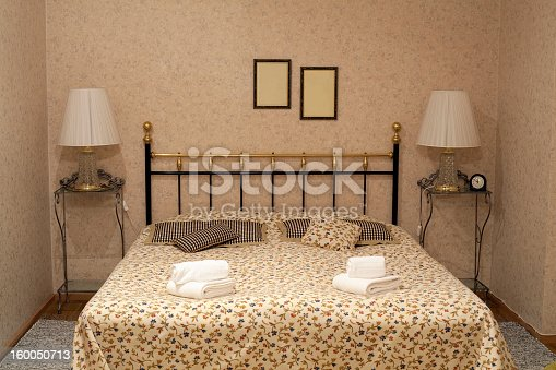 Luxury apartment, comfortable bedroom - double bed with bedside lamp