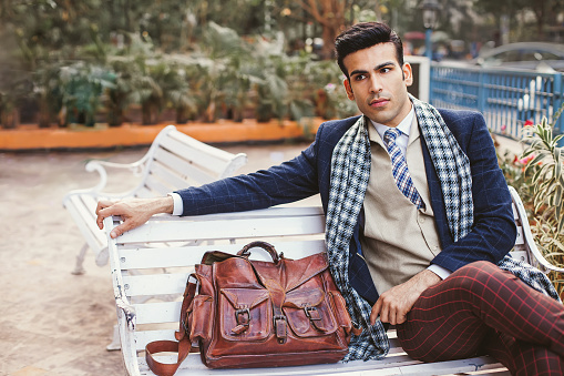 Handsome Indian man wearing vintage business clothes