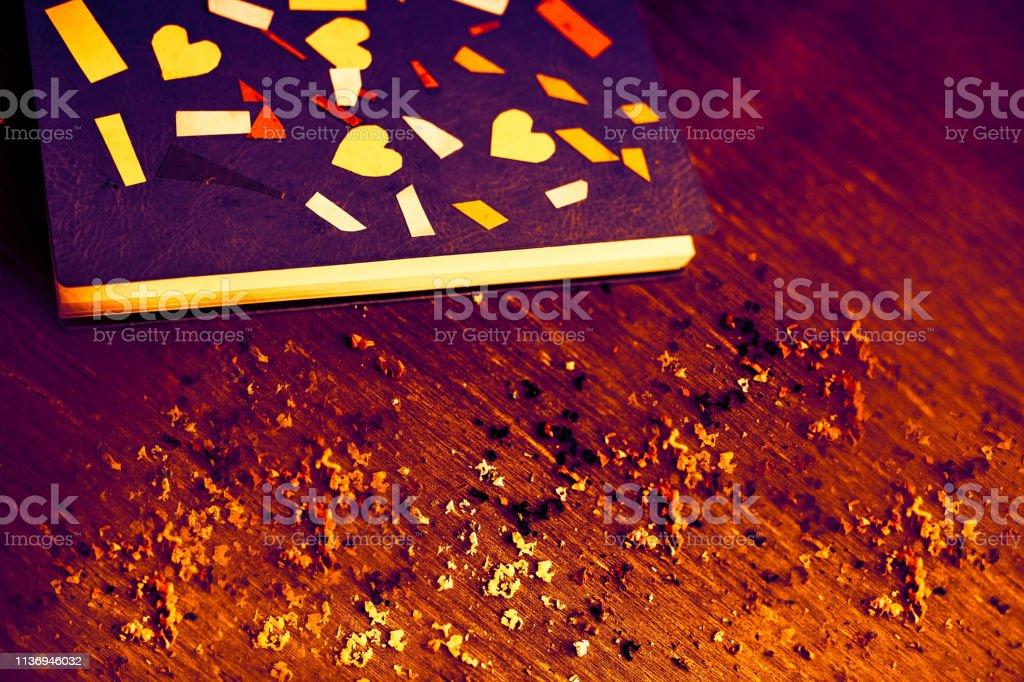 Vintage style photography. Crafted note book on old wooden surface....