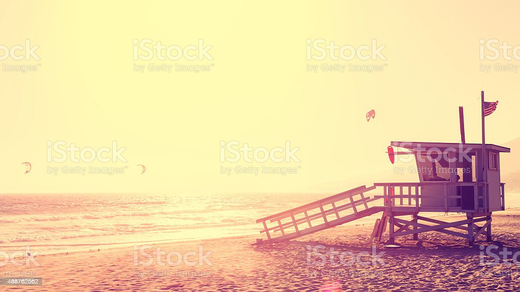 Vintage style picture of lifeguard tower at sunset in Malibu. stock photo