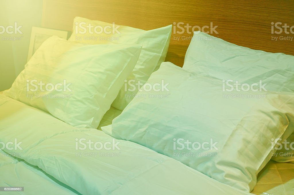 Vintage Style Pillow on bed with Sunlight. foto de stock royalty-free