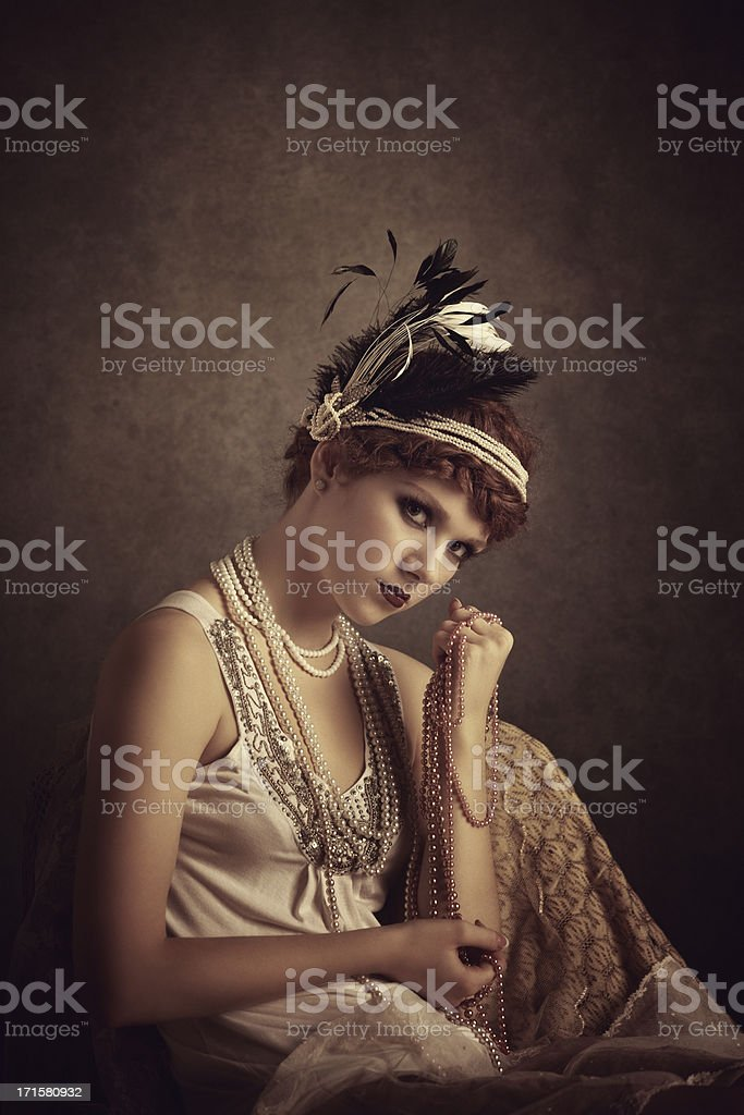 vintage style woman holding pearl necklaces royalty-free stock photo