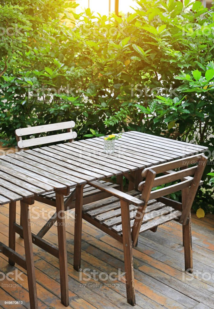 Vintage Style Wooden Table And Chair In The Garden Stock ...
