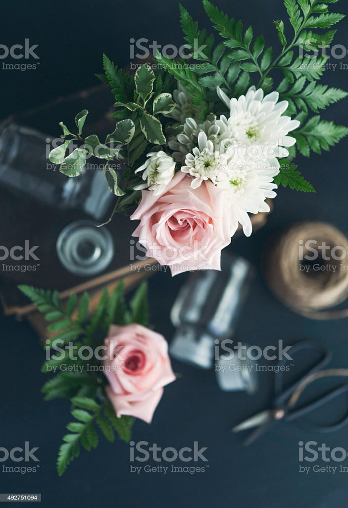 Vintage styled still life of flower arranging stock photo