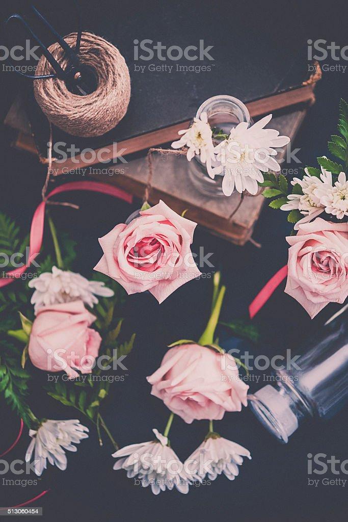 Vintage styled still life of flower arranging stock photo