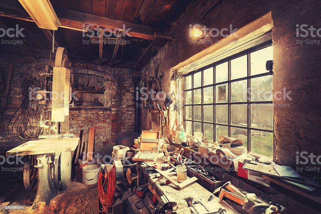Vintage stylized old carpenter workshop interior stock photo