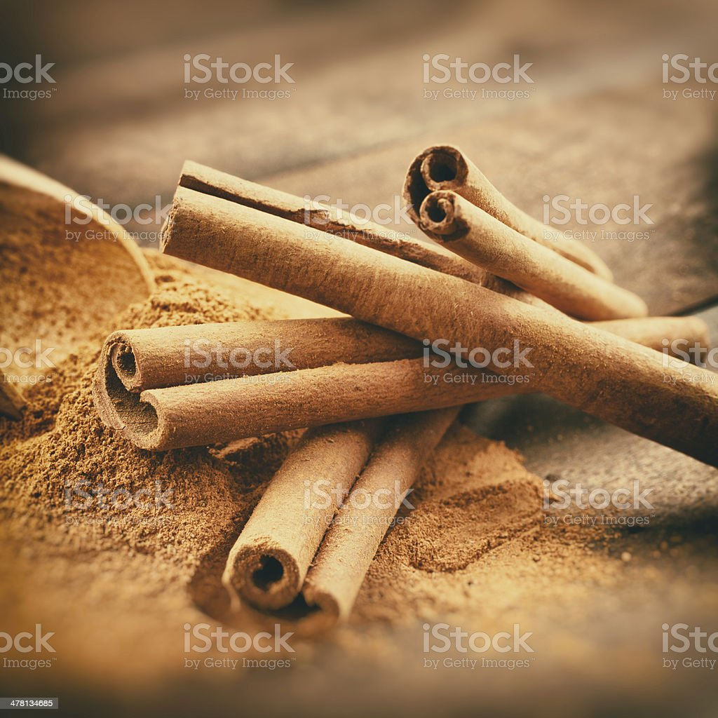 Vintage stylized photo of Cinnamon sticks and powder stock photo