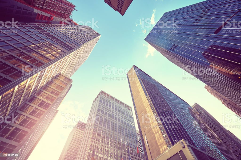 Vintage stylized photo of Manhattan skyscrapers at sunset, NYC. royalty-free stock photo