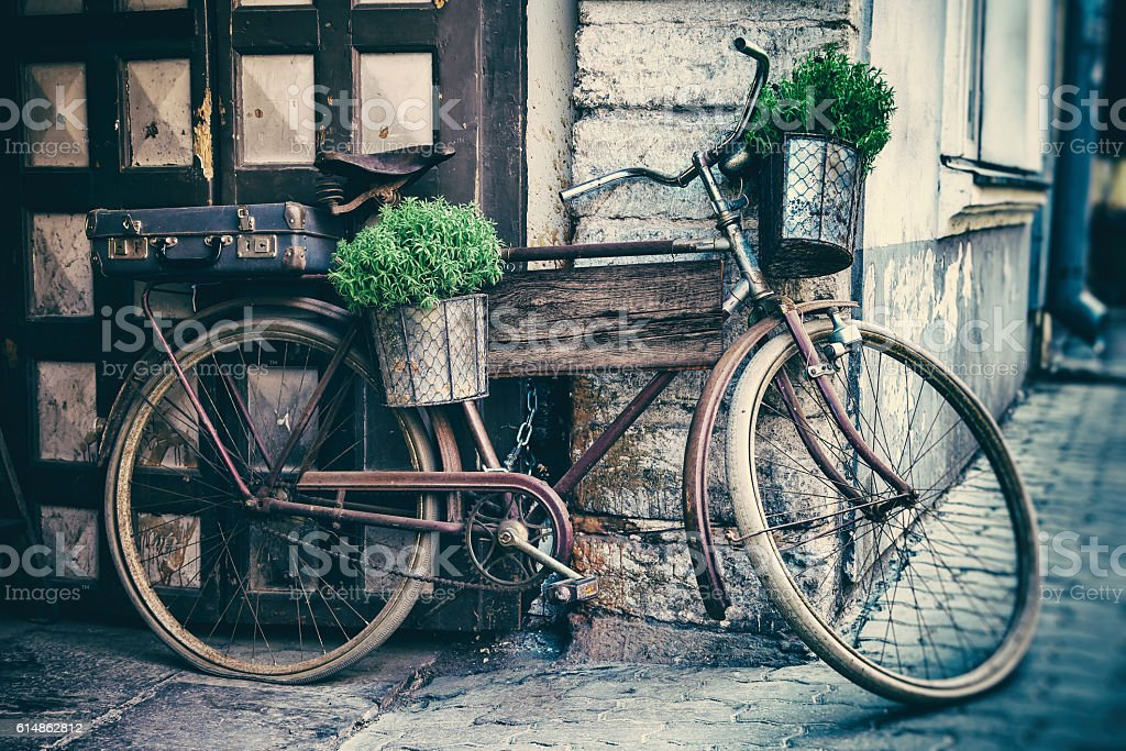Vintage stylized photo of old bicycle carrying flower pots - foto de acervo