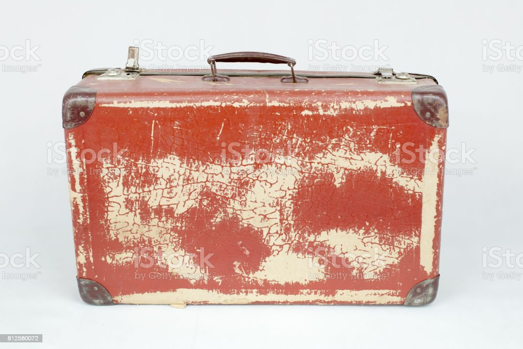 Vintage suitcase made of cardboard with hardware. Selected focus. - Stock  image .