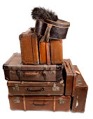 Vintage luggage suitcases stacked, ready to travel