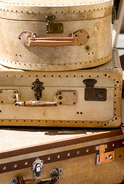 Vintage suitcases staked on top of each other stock photo