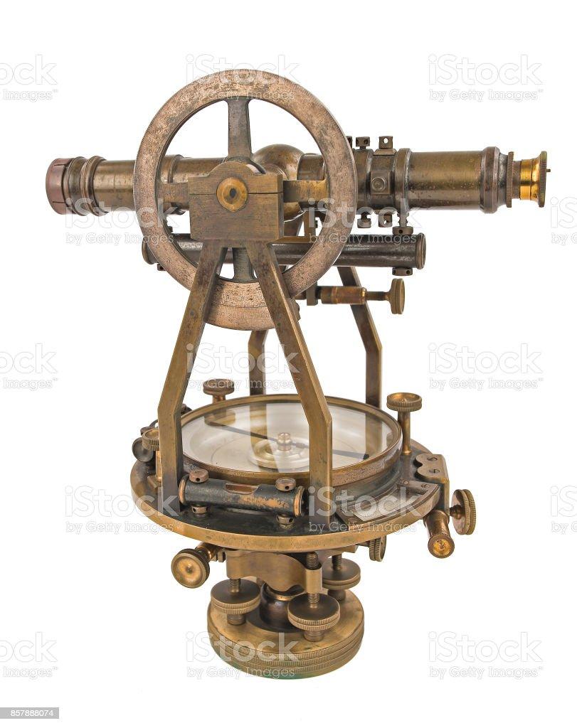 Vintage Surveyor's Level (Transit, Theodolite) with Compass isolated on White. stock photo